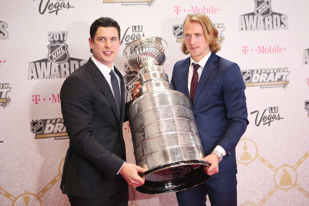 Sidney Crosby, left, and Carl Hagelin, right, are pictured with the Stanley Cup on the Magenta Carpet before the 2017 NHL Awards and Expansion Draft at T-Mobile Arena on Wednesday, June 21, 2017 i ...
