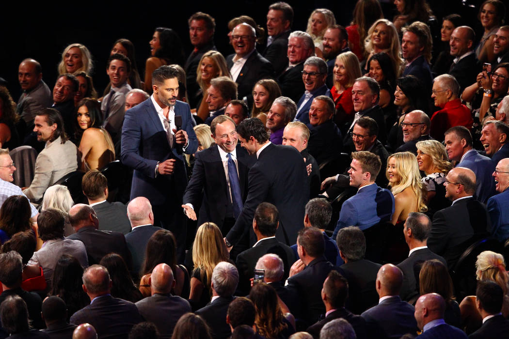 Host Joe Manganiello, left, and NHL Commissioner Gary Bettman greet Sidney Crosby of the Pittsburgh Penguins during the 2017 NHL Awards and Expansion Draft at T-Mobile Arena on Wednesday, June 21, ...