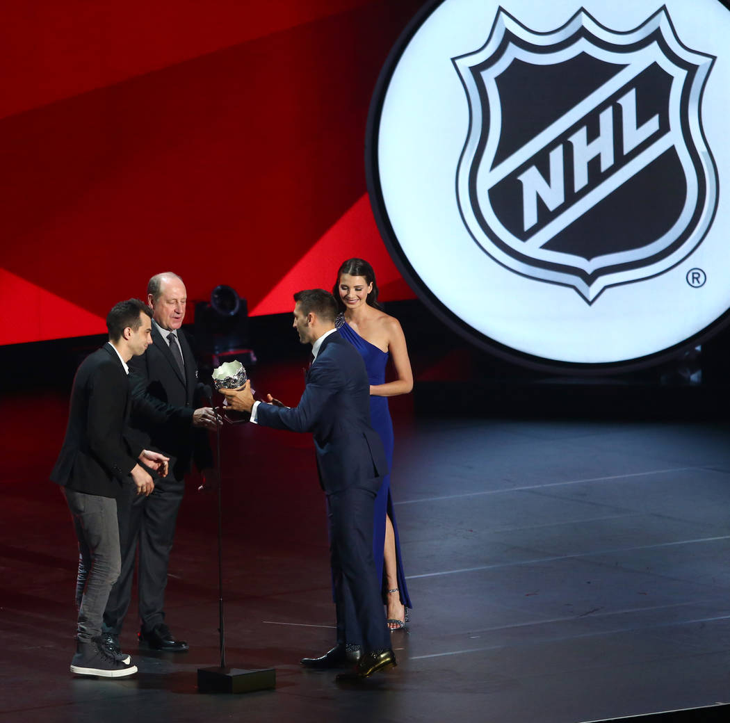Jay Baruchel, left and Bob Gainey present the Frank J. Selke Trophy (Forward Who Best Excels in the Defensive Aspects of the Game) to Patrice Bergeron of the Boston Bruins during the 2017 NHL Awar ...