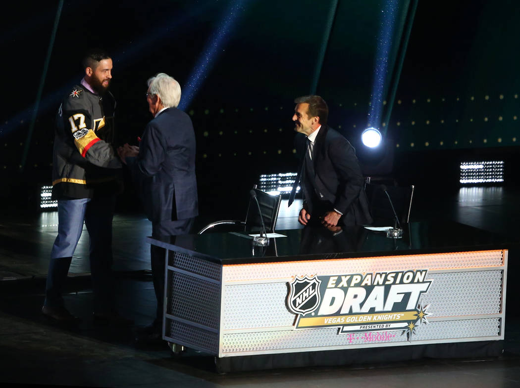 Defenseman Deryk Engelland is congratulated by Vegas Golden Knights owner Bill Foley after being drafted by the Knights in the NHL Expansion Draft at T-Mobile Arena on Wednesday, June 21, 2017 in  ...
