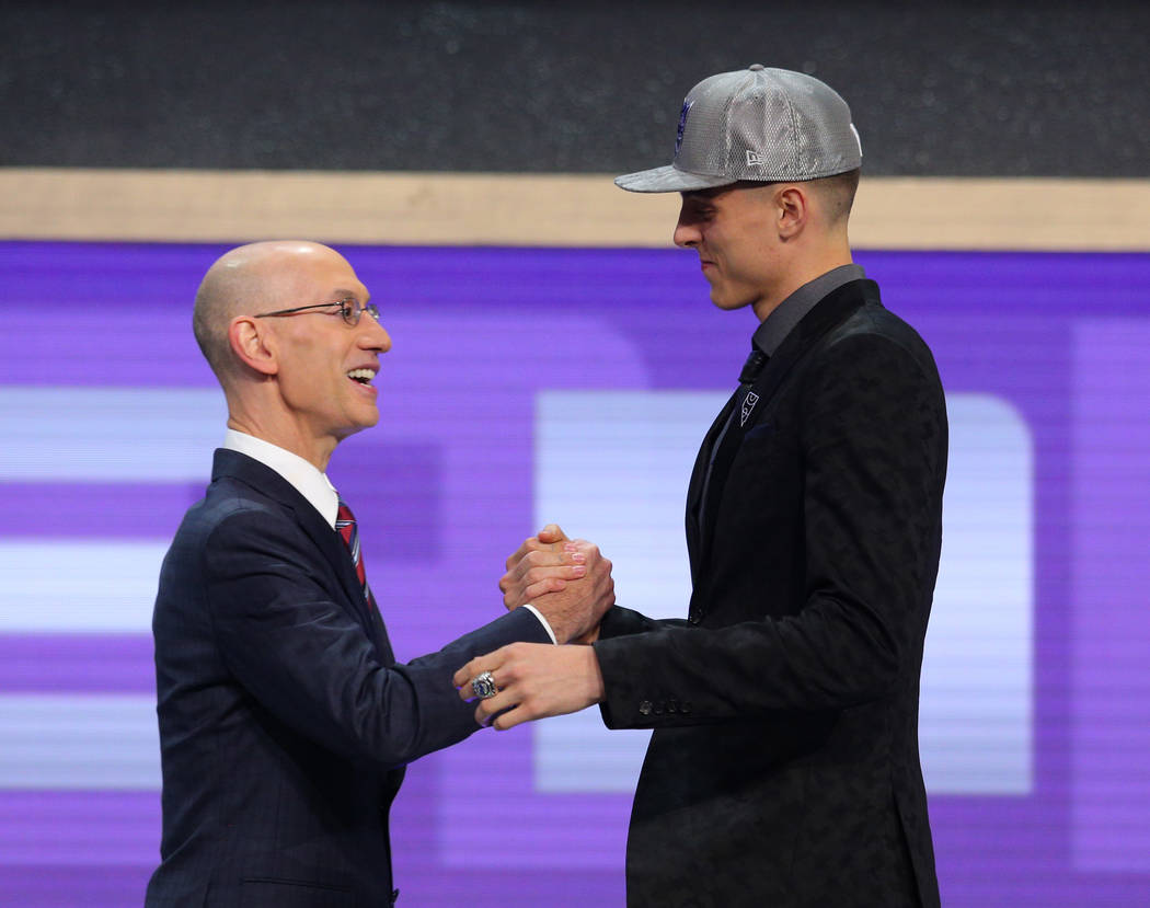 Jun 22, 2017; Brooklyn, NY, USA; Zach Collins (Gonzaga) is introduced by NBA commissioner Adam Silver as the number ten overall pick to the Sacramento Kings in the first round of the 2017 NBA Draf ...