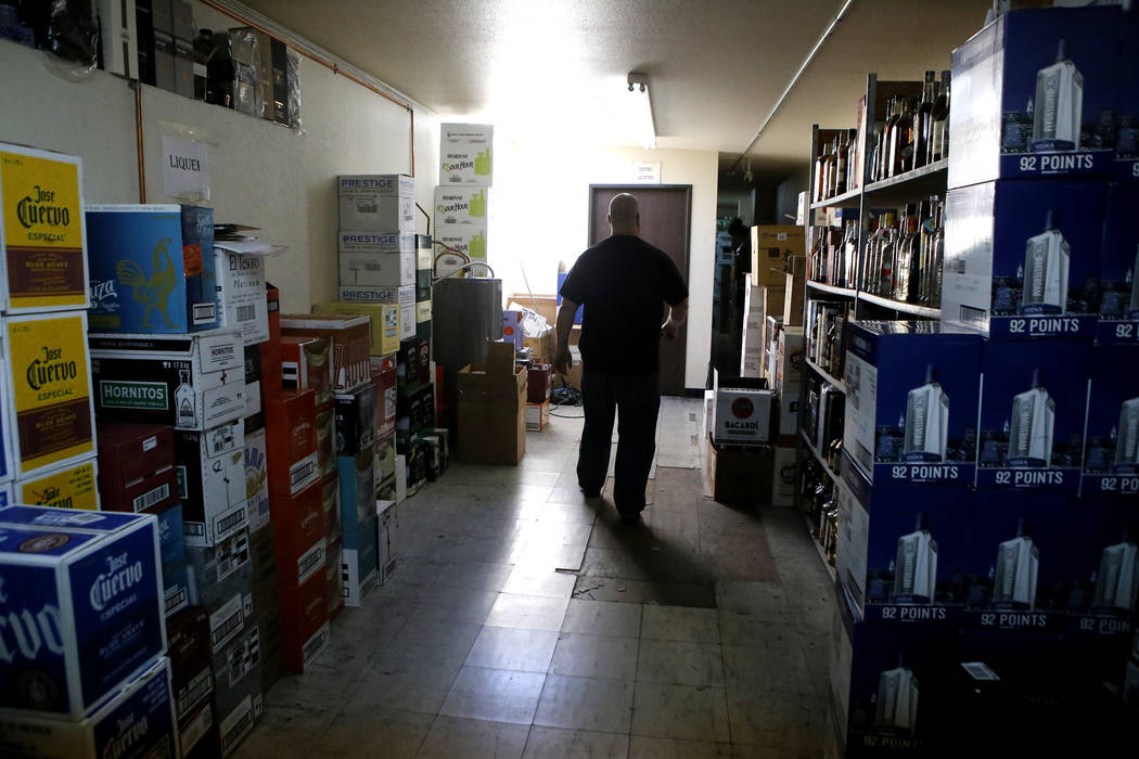 Charles Starr walks out of a room after storing bottles of liquor at Lee's Discount Liquor located at 1780 S Rainbow Blvd, on Tuesday, Feb. 28, 2017, in Las Vegas. (Christian K. Lee/Las Vegas Revi ...