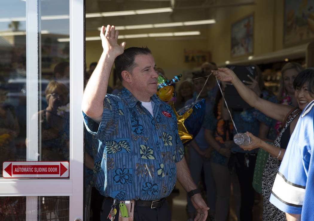Store captain Todd Rosenthal greets customers in line during the grand opening of the grand opening of Trader Joe's, 5639 Centennial Center Blvd., on Friday, June 23, 2017 in Las Vegas. Erik Verdu ...
