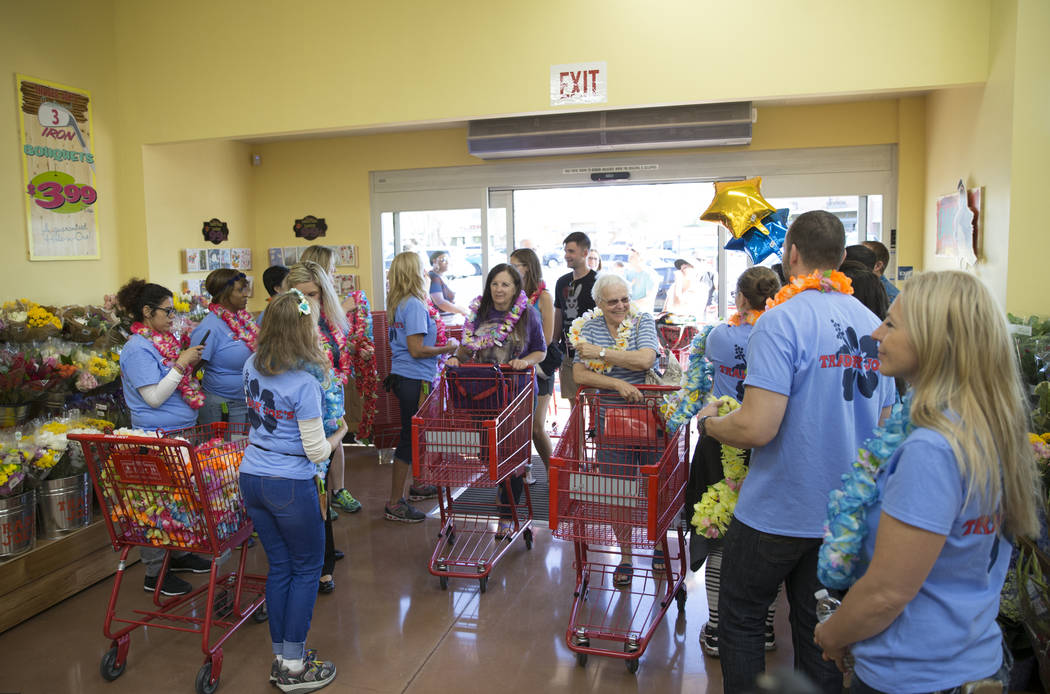 Customers are greeted by store employees during the grand opening of Trader Joe's, 5639 Centennial Center Blvd., on Friday, June 23, 2017 in Las Vegas. Erik Verduzco/Las Vegas Review-Journal
