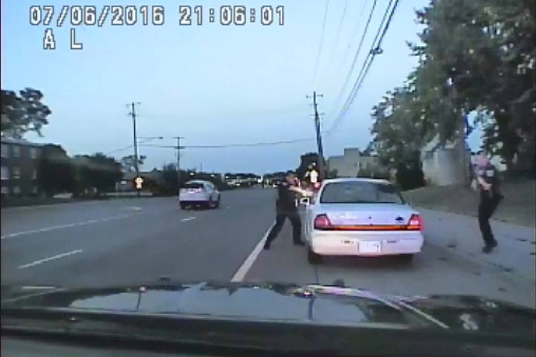 In this image made from July 6, 2016, video captured by a camera in the squad car of St. Anthony Police officer Jeronimo Yanez, the Minnesota police officer shoots at Philando Castile in the vehic ...