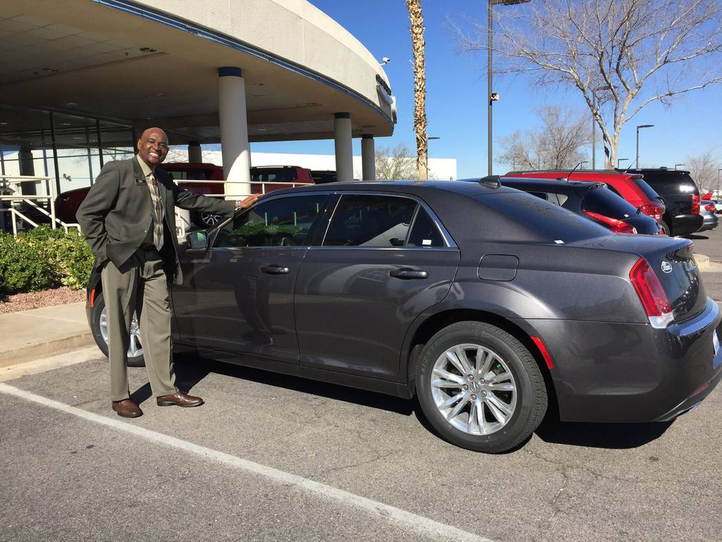 Chapman Automotive Chapman Automotive general sales manager Lawrence Ennis poses next to a new arrival 2017 Chrysler 300 at Chapman Chrysler Jeep.