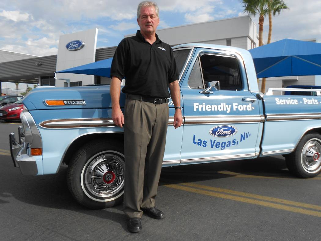 Friendly Ford Friendly Ford service director Greg Haase is seen with the dealership's 1970 Ford F-100.