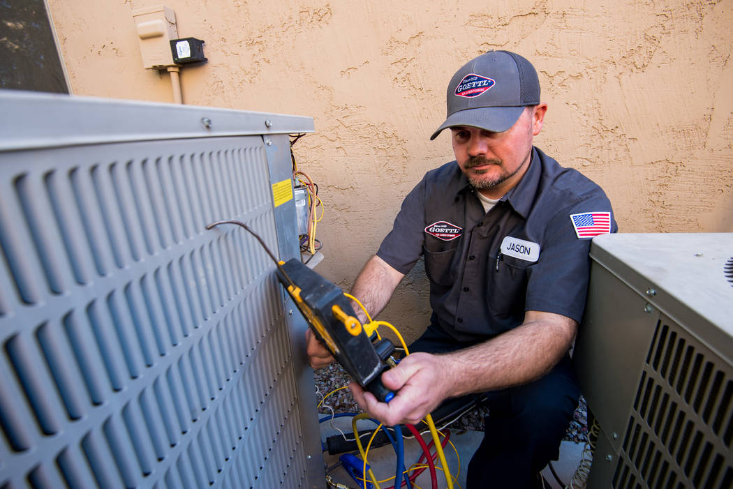 A Goettl Air Conditioning employee works in this file photo. (Goettl Air Conditioning)