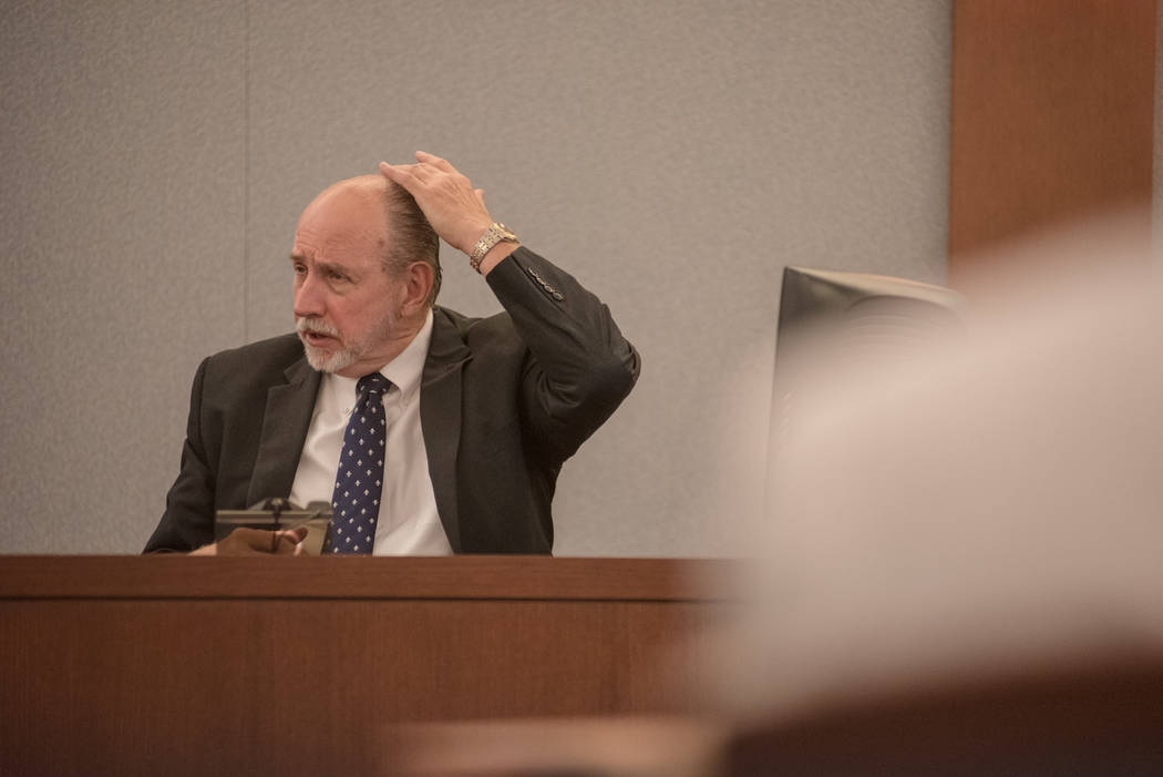 Dr. Lary Simms, Clark County Coroner, shares information about head gunshot wounds at Thomas Randolph's trial  on Wednesday, June 21, 2017, at Regional Justice Center in Las Vegas. Morgan Lieberma ...