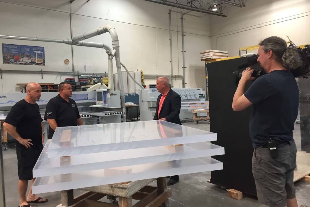 "Brett Raymer and Wayde King work with San Jose Sharks COO John Totora at Acrylic Tank Manufacturing for an upcoming episode of the Animal Planet series ""Tanked."" (Acrylic Tank Manufacturing)"