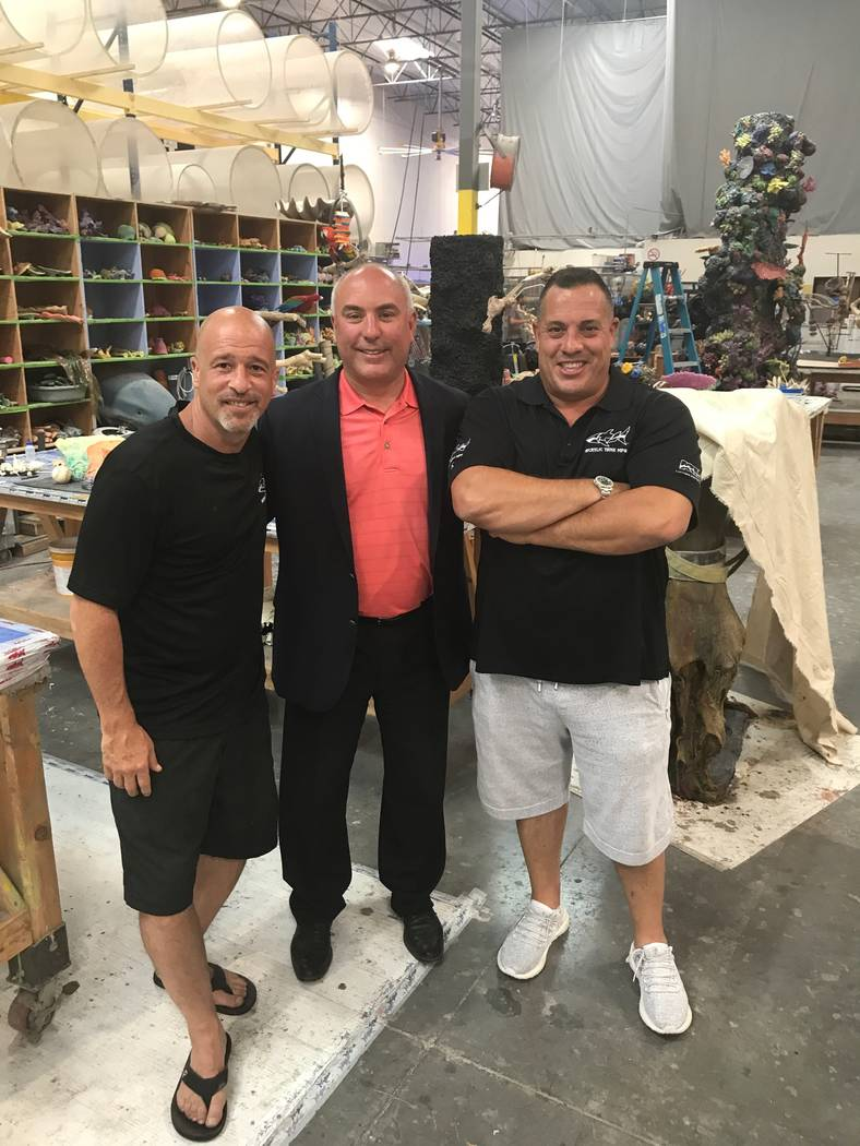 "Brett Raymer, left, and Wayde King, right, are shown with San Jose Sharks COO John Totora at Acrylic Tank Manufacturing during an upcoming episode of the Animal Planet series ""Tanked."" (Acrylic Ta ..."