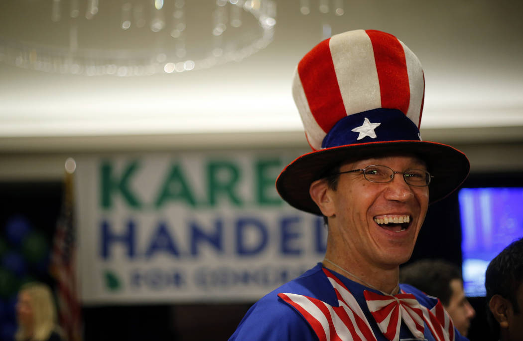 Peter Ludwinski of Sandy Springs, Ga., laughs as he waits for an election-night watch party to begin for Republican candidate for Georgia's Sixth District Congressional seat Karen Handel Tuesday,  ...