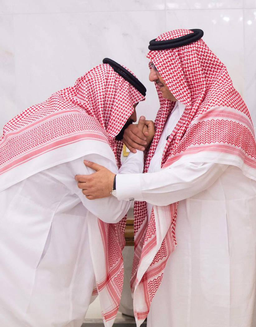 Mohammed bin Salman, newly appointed as crown prince, left, kisses the hand of Prince Mohammed bin Nayef at royal palace in Mecca, Saudi Arabia. (Al-Ekhbariya via AP)
