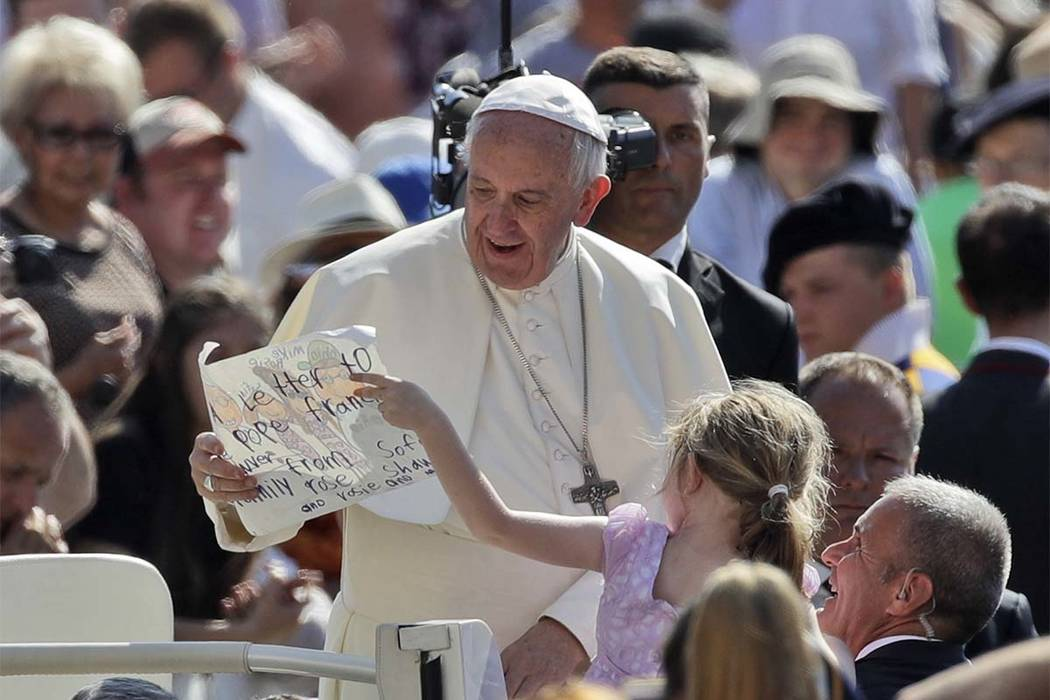 Pope Francis is presented with a drawing by a child as he arrives for his weekly general audience in St. Peter's Square at the Vatican, Wednesday, June 21, 2017. (Alessandra Tarantino/AP)