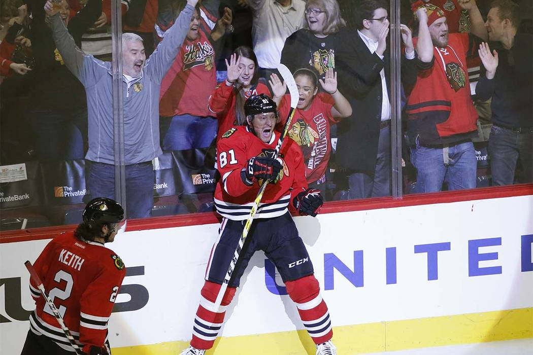 Chicago Blackhawks' Marian Hossa (81) celebrates a game-winning goal as Duncan Keith watches during the overtime period of an NHL hockey game against the New Jersey Devils, in Chicago. Hossa will  ...