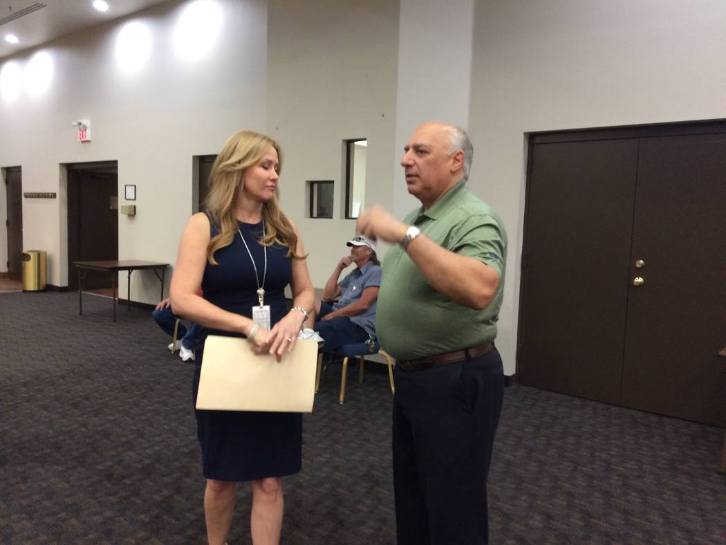 Gena Kendall, city traffic engineer, speaks with Stavros Anthony, city councilman, June 15, 2017, before a town hall meeting at Sun City Summerlin. Residents had a lot to say about the speed cushi ...