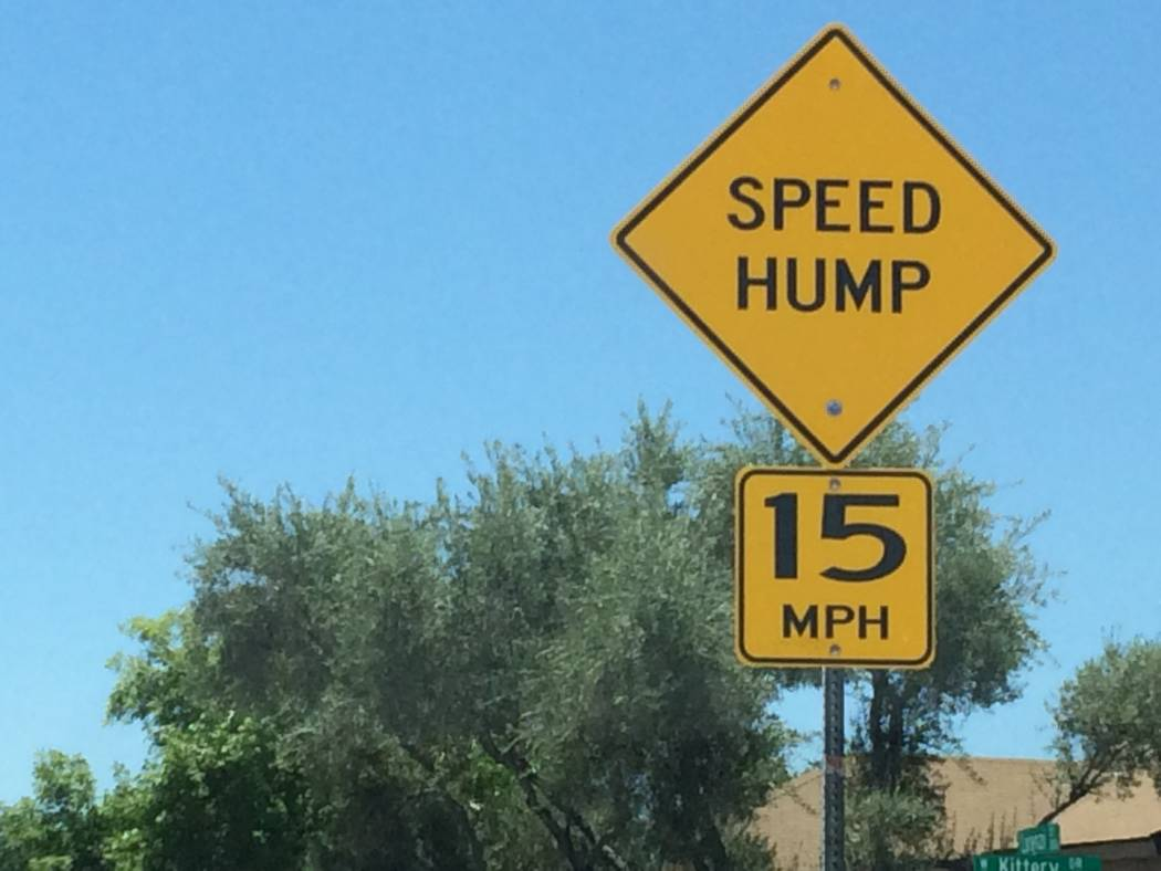 A sign, seen June 15, 2017, warns drivers that a speed hump has been installed to slow traffic, but the city said those were in appropriate for Sun City Summerlin. An experiment with speed cushion ...