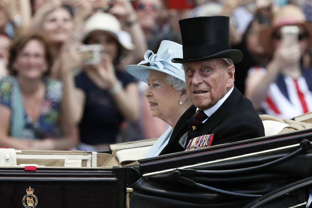 Britain's Queen Elizabeth II and Prince Philip return to Buckingham Palace in a carriage Saturday, June 17, 2017, after attending the annual Trooping the Colour Ceremony in London. Buckingham Pala ...