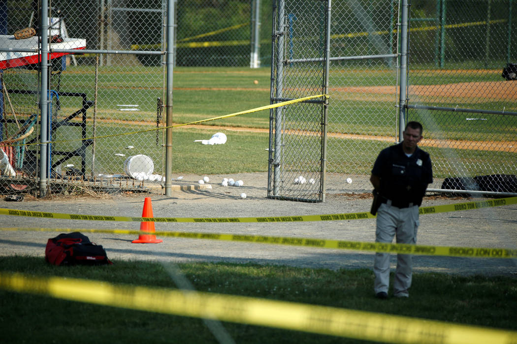 A police officer mans a shooting scene after a gunman opened fire on Republican members of Congress during a baseball practice near Washington in Alexandria, Virginia,  June 14, 2017. (Joshua Robe ...