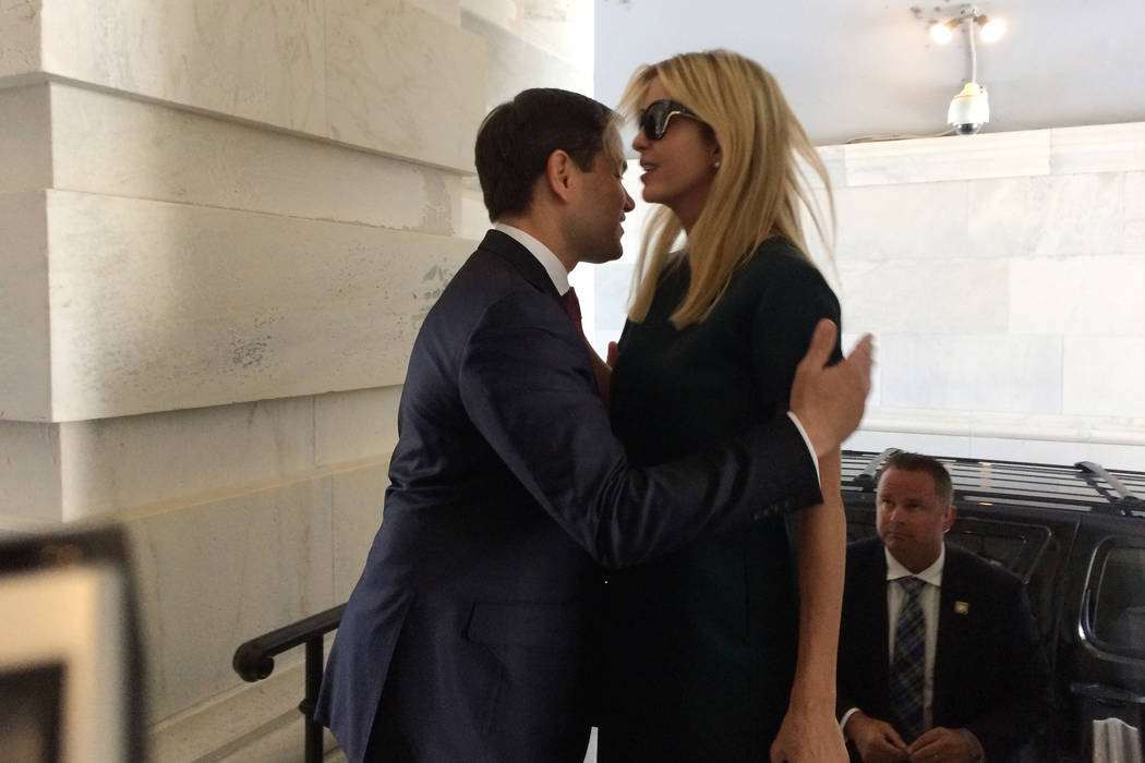 Sen. Marco Rubio, R-Fla., greets Ivanka Trump, daughter of President Donald Trump, as she arrives at the Capitol to meet with lawmakers about parental leave, in Washington, Tuesday, June 20, 2017. ...