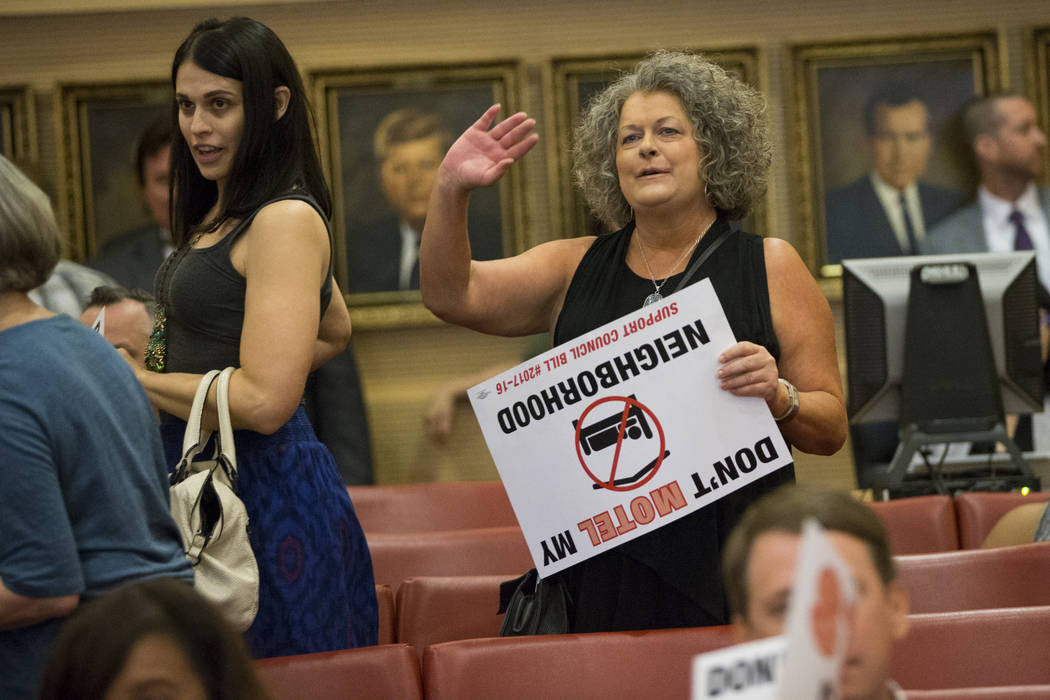 Local resident Shelly, right, waves at the council members after their vote regarding short-term rentals during a city council meeting at Las Vegas City Hall on Wednesday, June 21, 2017, in Las Ve ...