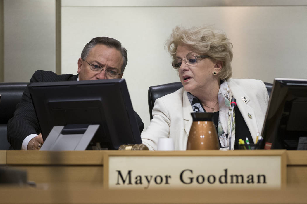 Councilman Steve Ross, left, looks over to the screen of Mayor Carolyn Goodman after she voted incorrectly during a city council meeting discussing short-term rentals at Las Vegas City Hall on Wed ...