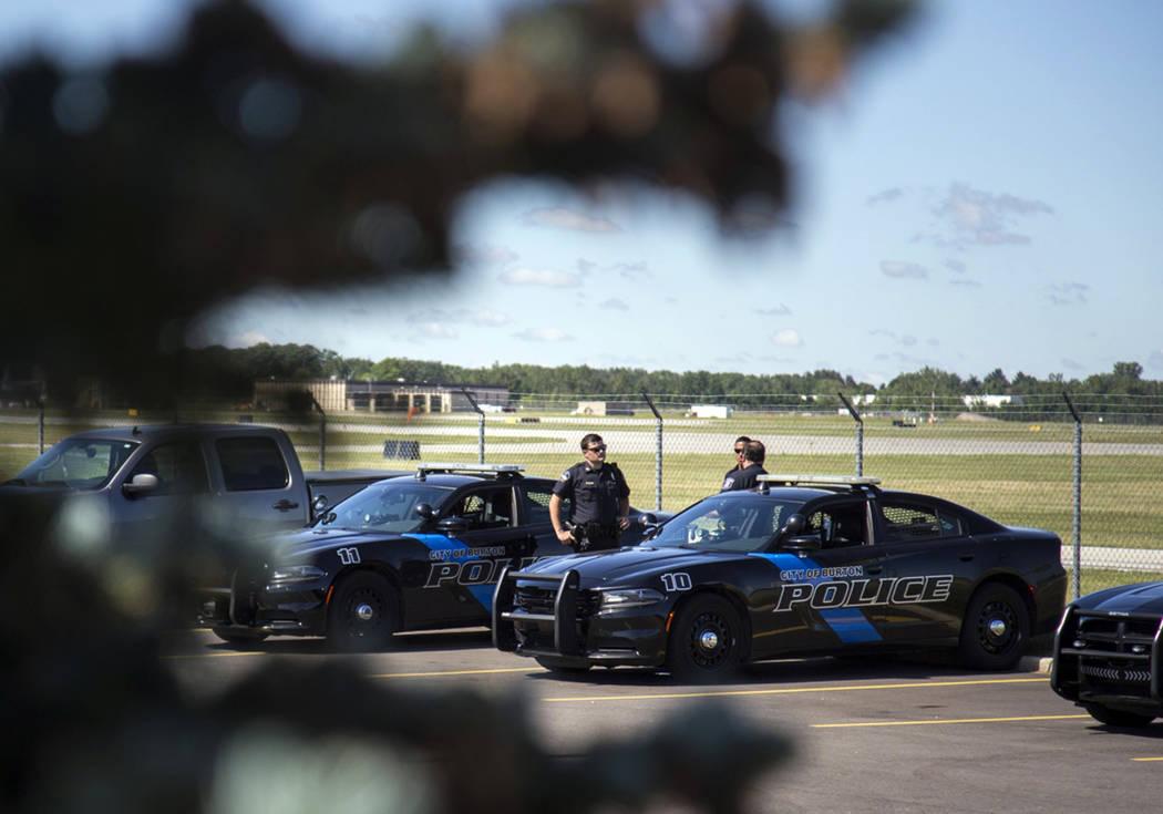 Burton Police Officers gather at Bishop International Airport, Wednesday morning, June 21, 2017, in Flint, Mich. (Shannon Millard/The Flint Journal-MLive.com via AP)