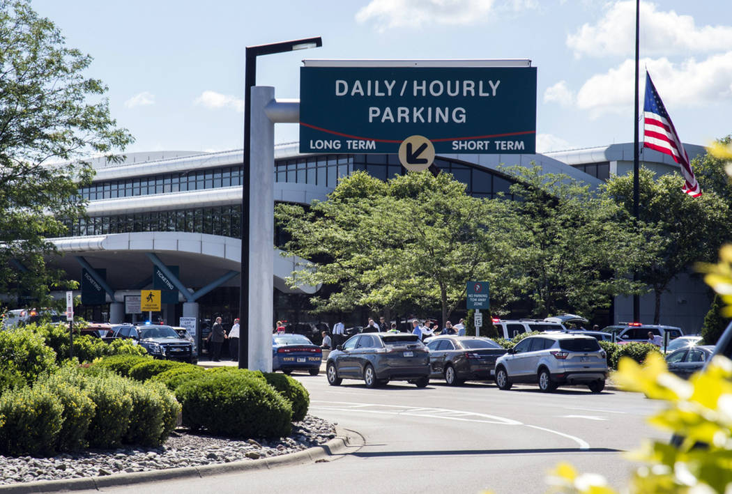 Travellers and traffic sit outside a terminal at Bishop International Airport, Wednesday morning, June 21, 2017, in Flint, Mich. (Shannon Millard/The Flint Journal-MLive.com via AP)