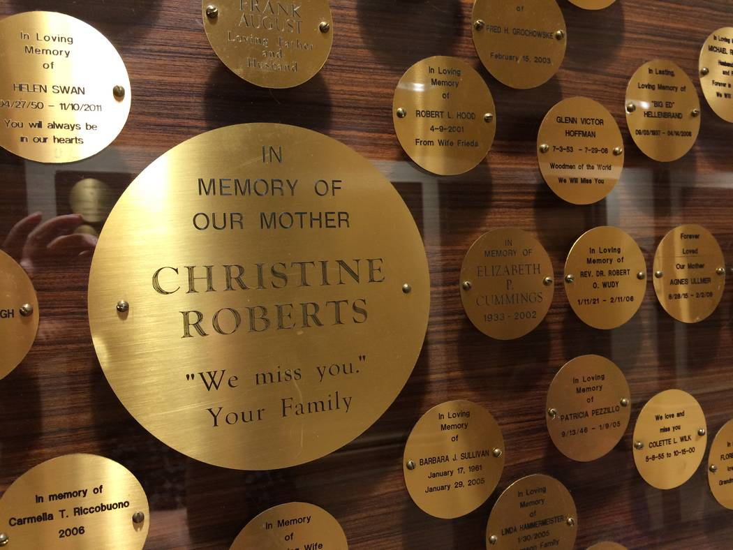 The wall at Nathan Adelson's Swenson facility is seen June 6, 2017, marked by gold medallions noting those who contributed to the hospice in honor of their loved one who died there. (JAN HOGAN/View)