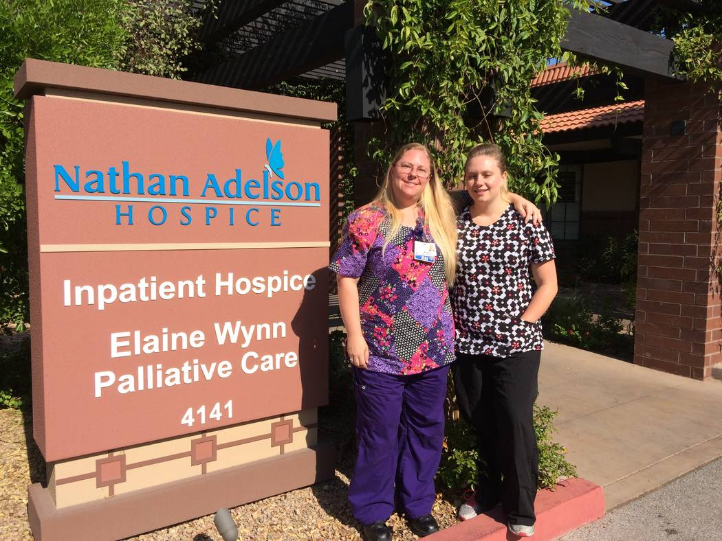 Misty Ashworth, RN, in floral print, and Jade Petersen, certified nurse assistant, pose at the entrance to the Nathan Adelson Hospice facility on Swenson June 6, 2017. Both said there is an emotio ...