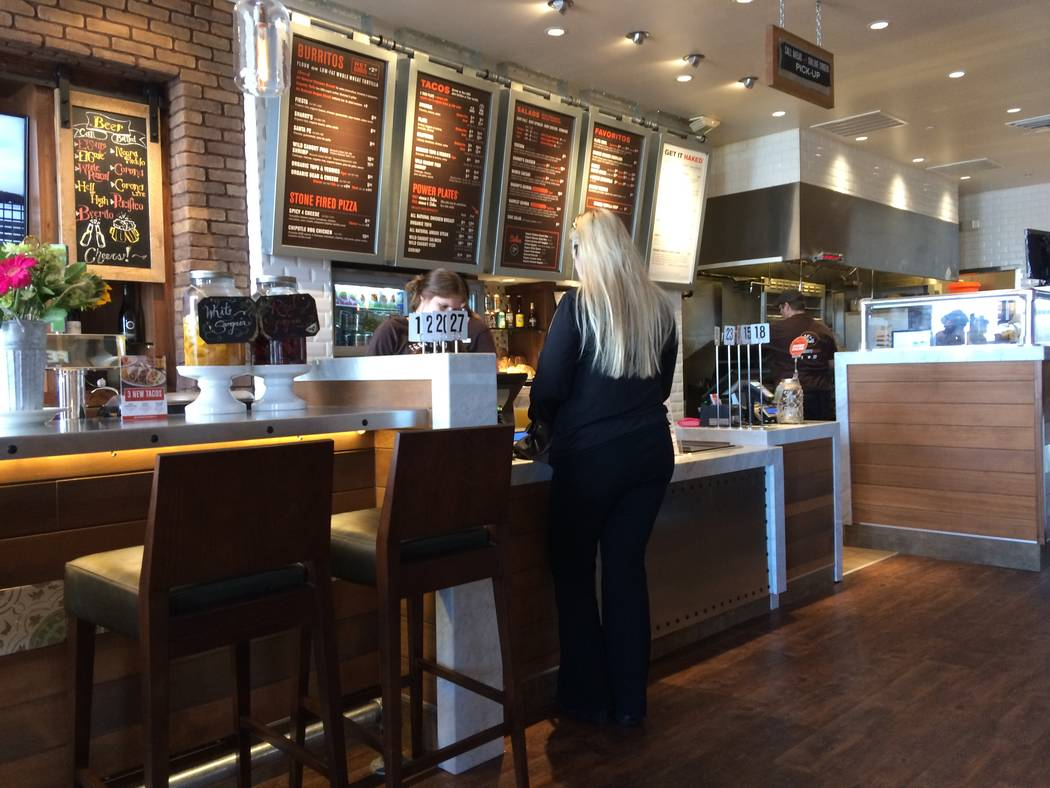 A patient orders take out at Sharkey's Woodfired Mexican Grill, Sharkey's, 8975 W. Charleston Blvd., June 2, 2017. The brand has come to the Summerlin area after proving itself with several loca ...