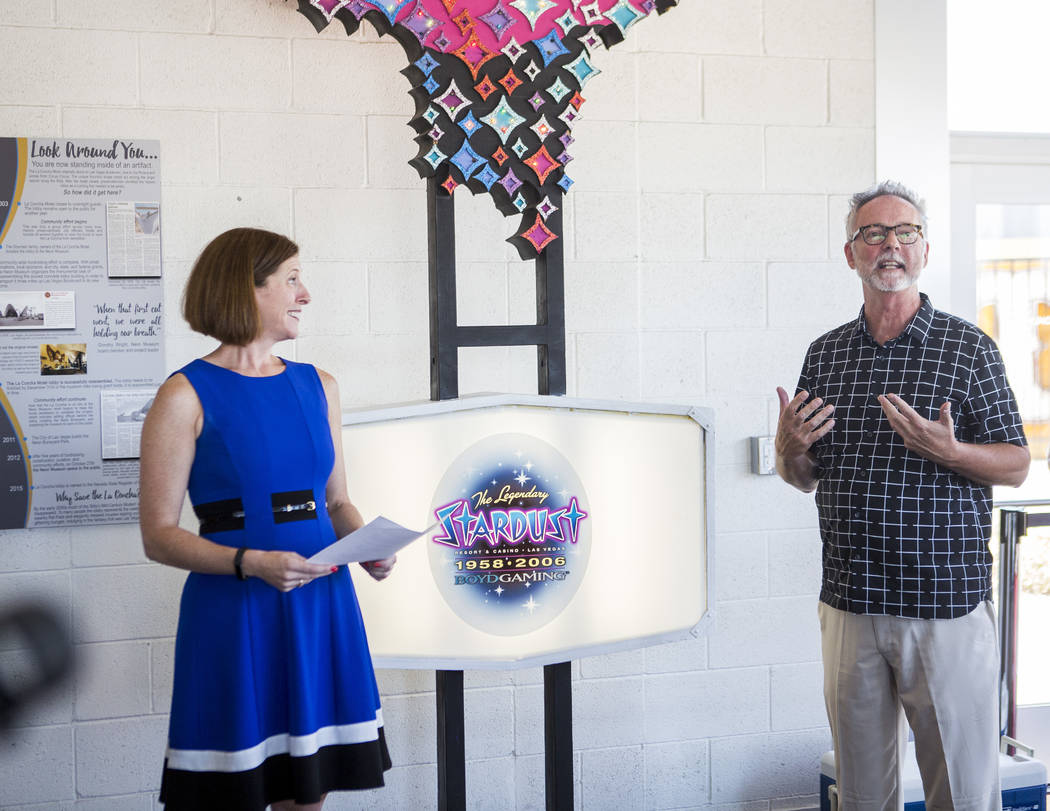 Rob McCoy, president and chief executive officer of the Neon Museum, talks to the media with Lori Nelson, vice president of corporate communications at Station Casinos, during the unveiling of ret ...