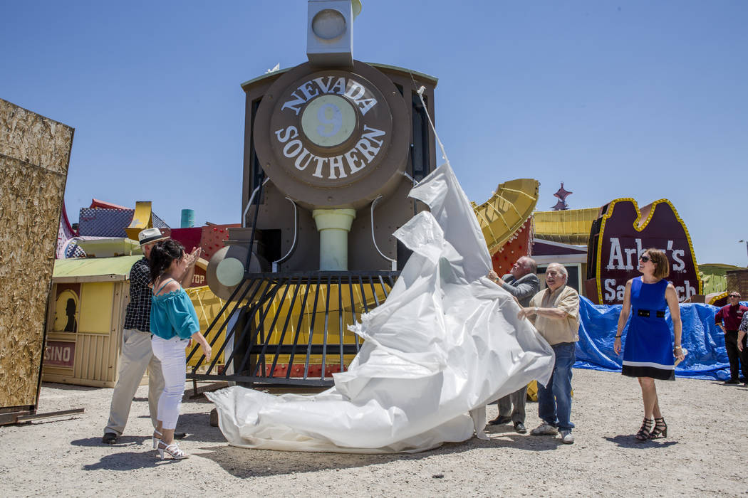Rob McCoy, president and CEO of the Neon Museum, Cathie Cabrera, a long time casino employee, Scott Nelson, vice president and general manager of Palace Station, Alan Cohen, a longtime casino empl ...