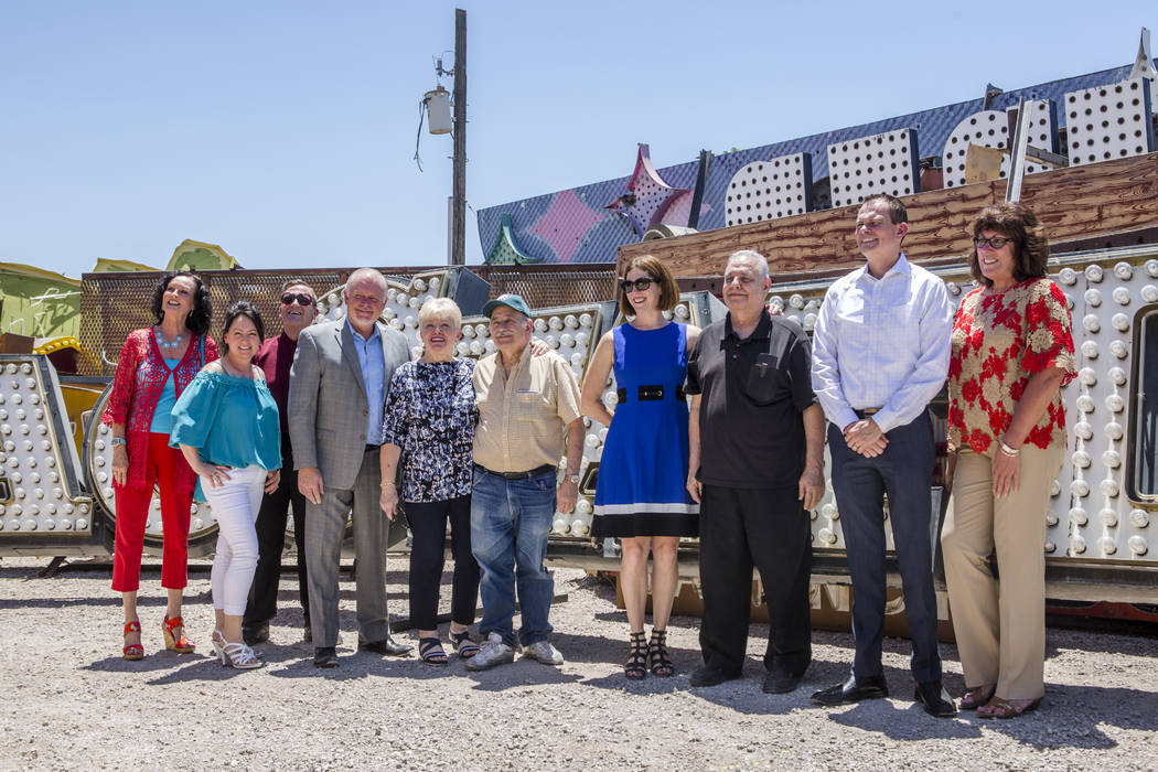 Scott Nelson, vice president and general manager of Palace Station, fourth from left, celebrate with his staff and guests after unveiling retired Palace Station signs, the latest contribution to t ...