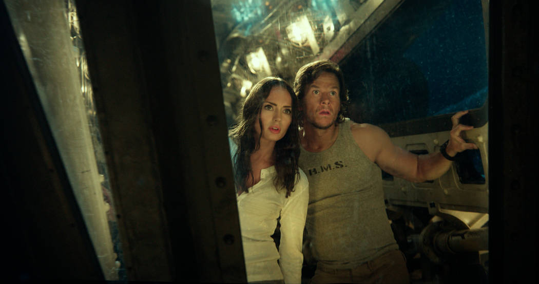 Left to right: Laura Haddock as Viviane Wembly and Mark Wahlberg as Cade Yeager in'Transformers: The Last Knight' , from Paramount Pictures.