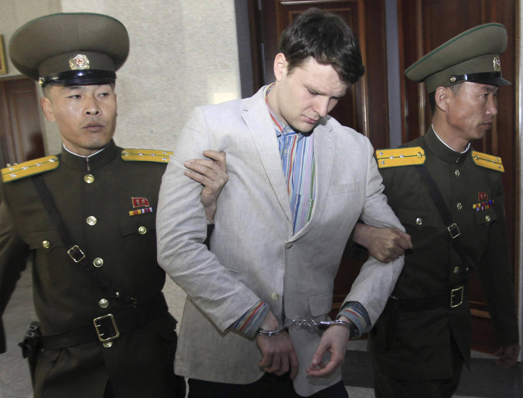 American student Otto Warmbier, center, is escorted at the Supreme Court in Pyongyang, North Korea on March 16, 2016. Warmbier, an American college student who was released by North Korea in a com ...