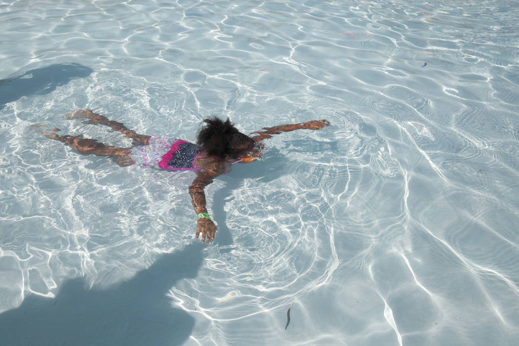 Maya Williams, 5, floats as people around her attempt to break the world record for largest swimming lesson at Wet 'n' Wild Las Vegas, Thursday, June 22, 2017. The event was an effort to raise awa ...