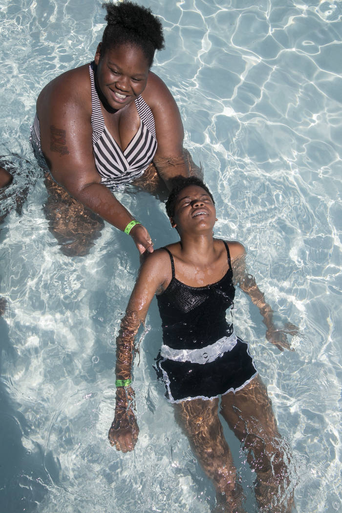 Nikki Walker, 23, left, helps Kiyah Mims, 14, float on her back while attempting to break the world record for largest swimming lesson at Wet 'n' Wild Las Vegas, Thursday, June 22, 2017. The event ...