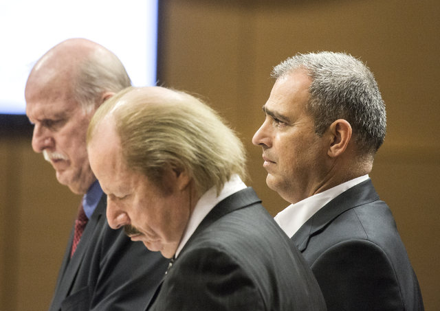 Developer Yohan Lowie, right, CEO and founder of EHB Companies, listens while developers attorneys Chris Kaempfer, left, and Jim Jimmerson address the Las Vegas City Council during a public hearin ...