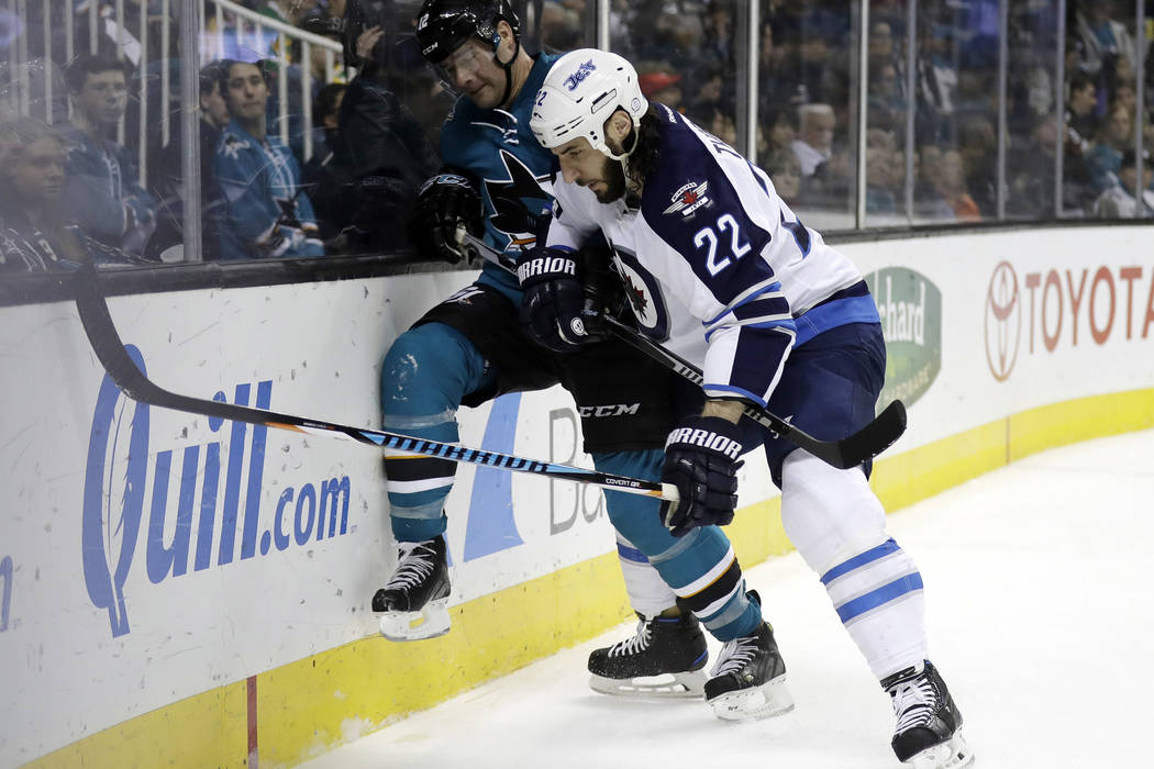 San Jose Sharks' Patrick Marleau, left, is pushed against the boards against Winnipeg Jets' Chris Thorburn (22) during the second period of an NHL hockey game Monday, Jan. 16, 2017, in San Jose, C ...