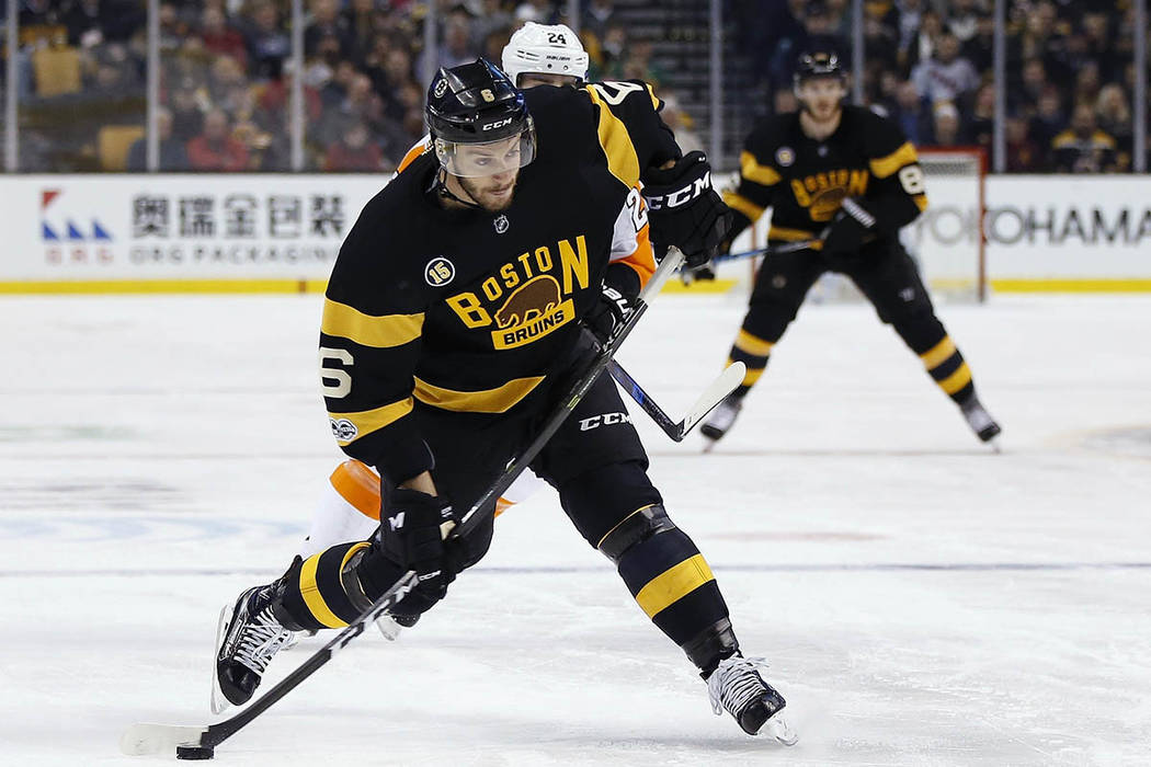 Boston Bruins' Colin Miller (6) takes a shot during the second period of an NHL hockey game against the Philadelphia Flyers in Boston, Saturday, March 11, 2017. (AP Photo/Michael Dwyer)