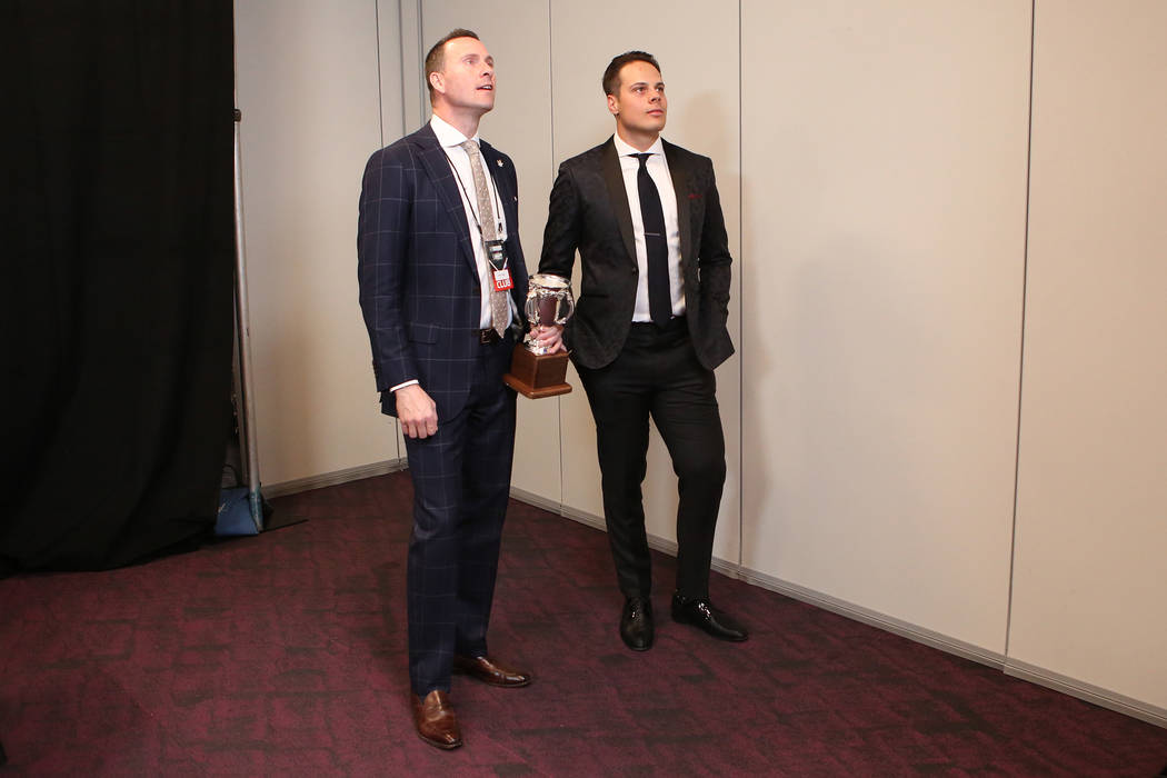 Auston Matthews of the Toronto Maple Leafs, right, watches a television for awards to be announced at the 2017 NHL Awards after being awarded the Calder Memorial Trophy at T-Mobile Arena on Wednes ...