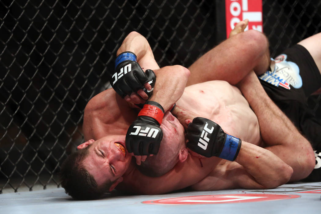 Steven Siler, left, in action, against Kurt Holobaugh during their UFC 159 Mixed Martial Arts bout in Newark, NJ, Saturday, April 27,2013.  Steven Siler won via 3 round unanimous decison. (AP Phot ...