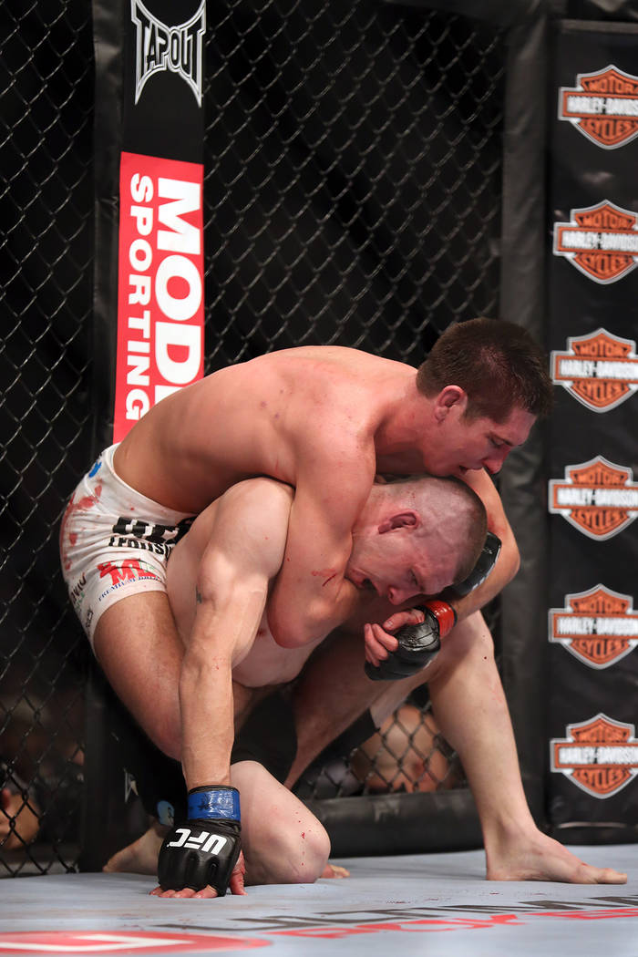 Steven Siler, top, in action, against Kurt Holobaugh during their UFC 159 Mixed Martial Arts bout in Newark, NJ, Saturday, April 27,2013.  Steven Siler won via 3 round unanimous decison. (AP Photo ...