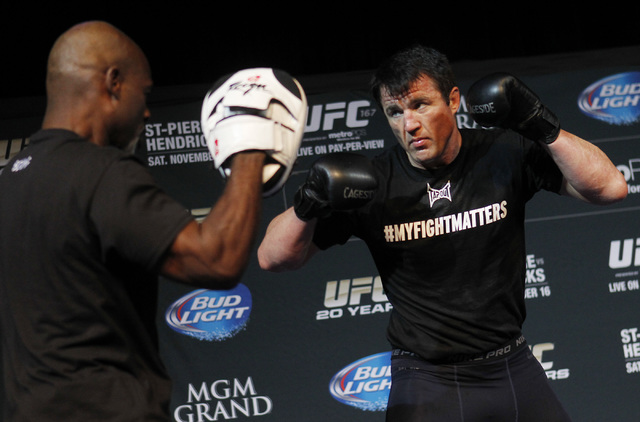 Fighter Chael Sonnen, right, spars during a media workout session for UFC 163 in the Hollywood Theater at the MGM Grand in Las Vegas on Nov. 13, 2013. (Jason Bean /Las Vegas Review-Journal)