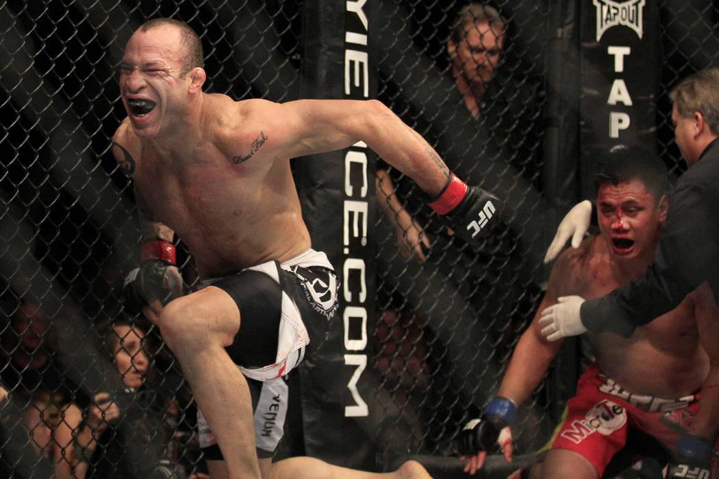 Wanderlei Silva, left, celebrates after beating Cung Le, right, during the second round of a UFC 139 Mixed Martial Arts middleweight bout in San Jose, Calif., Saturday, Nov. 19, 2011. Silva won by ...