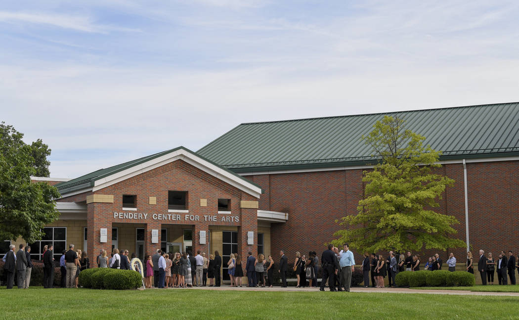 Mourners line up for the funeral of Otto Warmbier, Thursday, June 22, 2017, in Wyoming, Ohio. Warmbier, a 22-year-old University of Virginia undergraduate student who was sentenced in March 2016 t ...