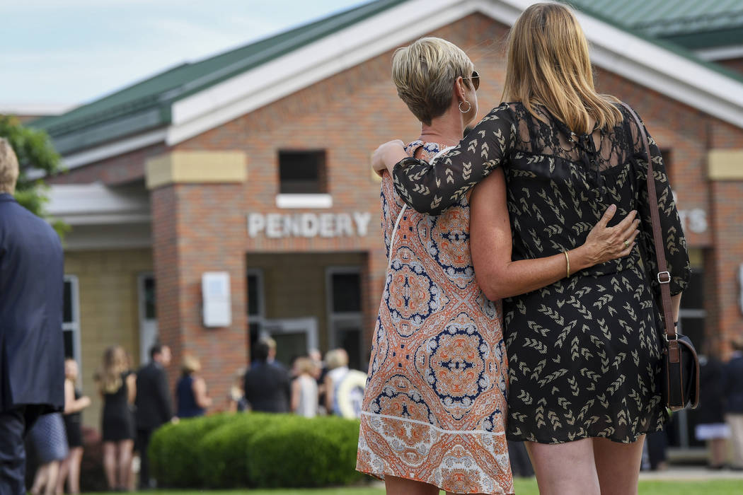 Mourners embrace as they arrive for the funeral of Otto Warmbier, Thursday, June 22, 2017, in Wyoming, Ohio. Warmbier, a 22-year-old University of Virginia undergraduate student who was sentenced  ...
