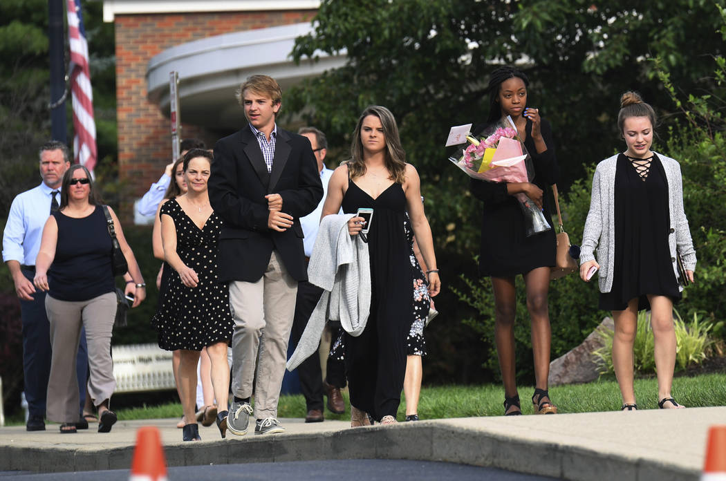 Mourners arrive for the funeral of Otto Warmbier, Thursday, June 22, 2017, in Wyoming, Ohio. Warmbier, a 22-year-old University of Virginia undergraduate student who was sentenced in March 2016 to ...