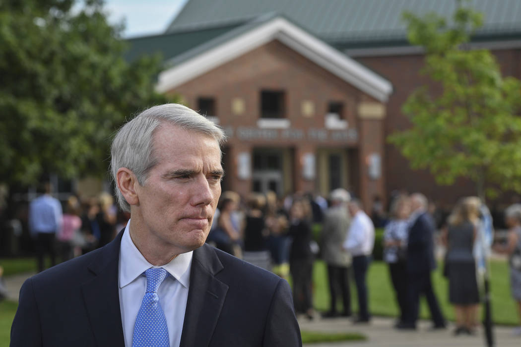 Sen. Rob Portman, R-Ohio, speaks to the press before the funeral of Otto Warmbier, Thursday, June 22, 2017, in Wyoming, Ohio. Warmbier, a 22-year-old University of Virginia undergraduate student w ...